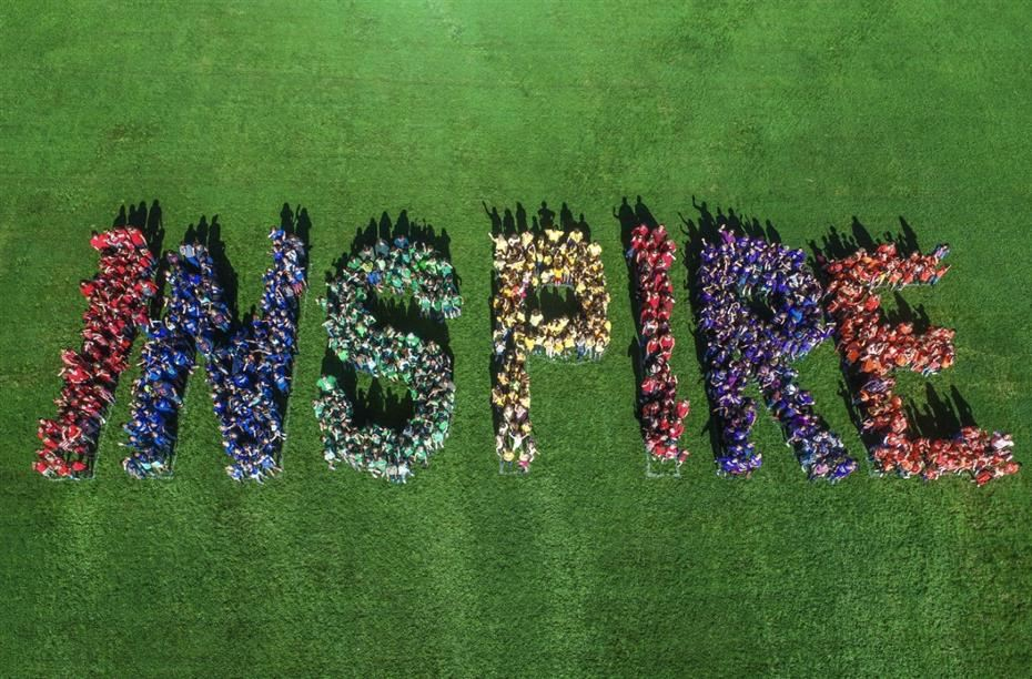 students spelling out inspire