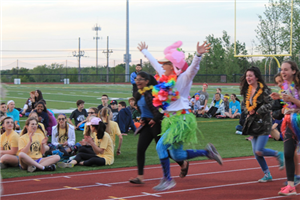 People dressed in costumes running