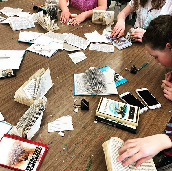 Students working on altered books