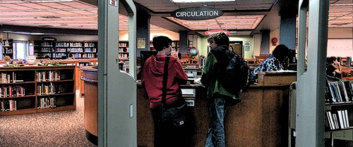students at library desk