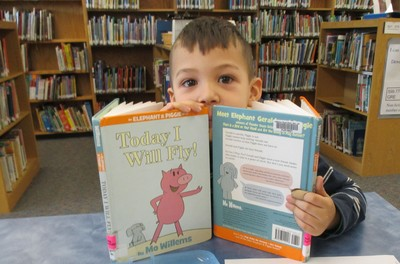boy looking over books crop.jpg