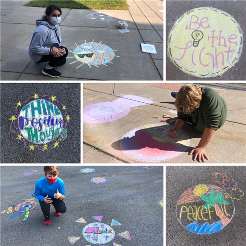 sidewalk chalk designs near the high school entrances