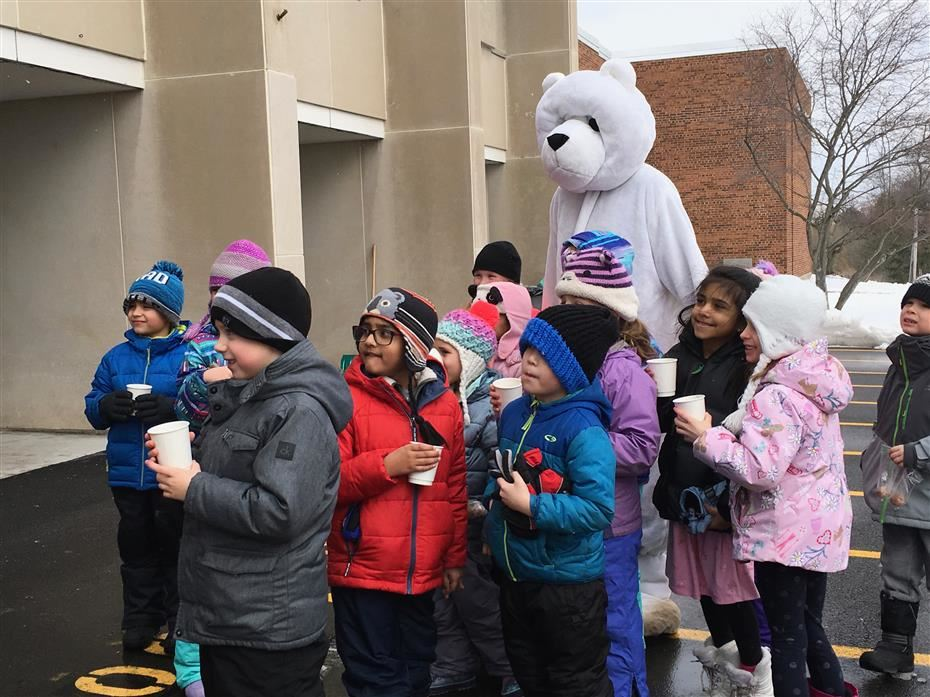 Students at Polar Walk with polar bear mascot.