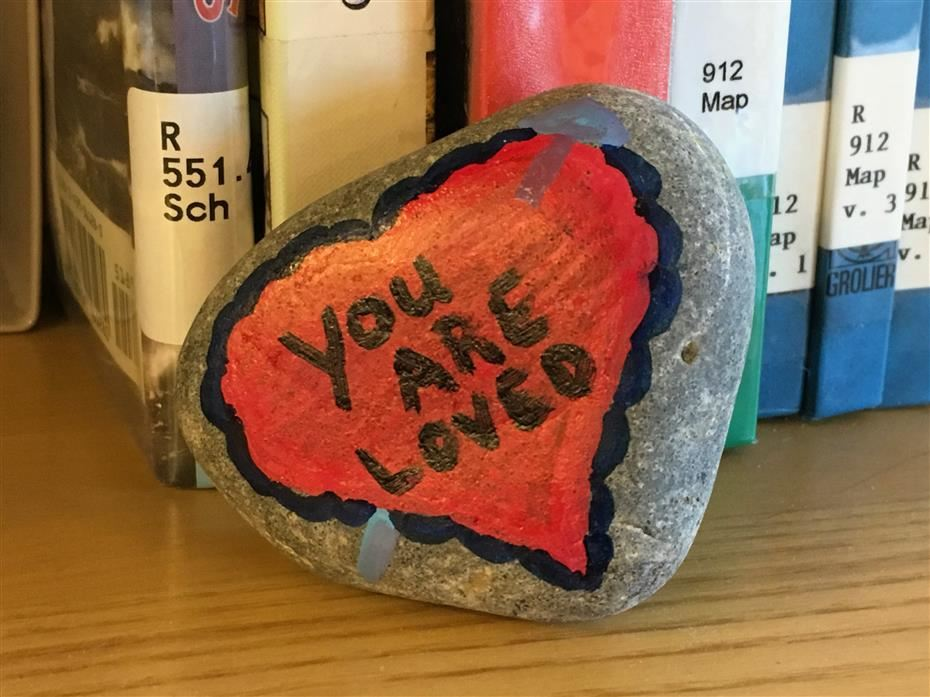 Rock with an inspirational message painted on it.