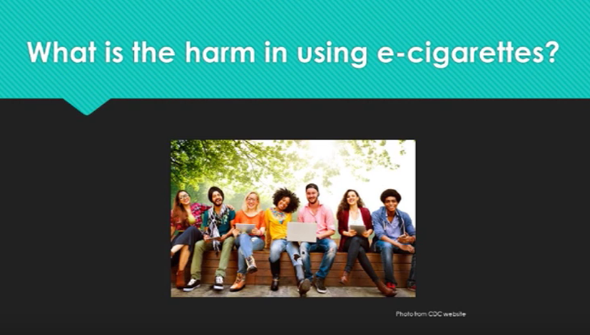 Students siting outside with the works what is the harm in using e-cigarettes