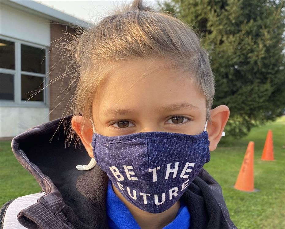 student wearing a face mask that says BE THE FUTURE