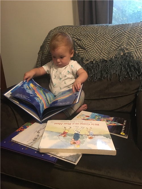 My daughter, June, doing her mom's favorite thing: reading!